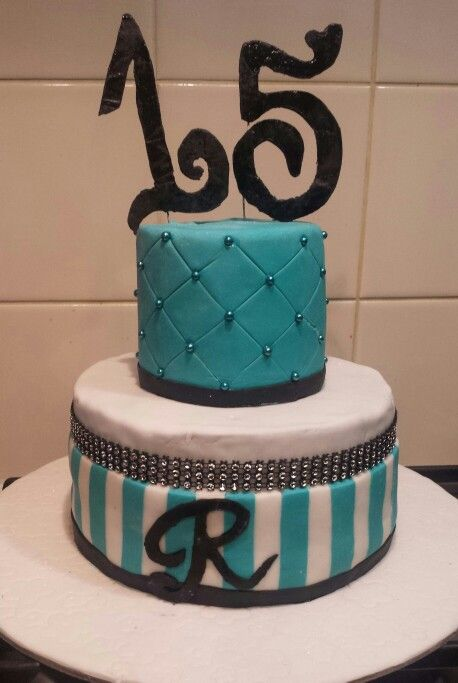 15th birthday cake Teal, white and black tiffany inspired cake Bottom tier: white chocolate mud cake with strawberries and strawberry buttercream covered in chocolate ganache. Top tier: white chocolate mud cake with strawberry buttercream covered in white chocolate ganache.