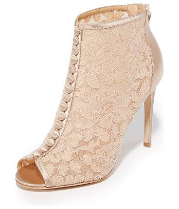 Nerina lace open toe booties by Badgley Mischka. These open toe Badgley Mischka booties are made from elegant lace and trimmed in tonal satin. Cov...