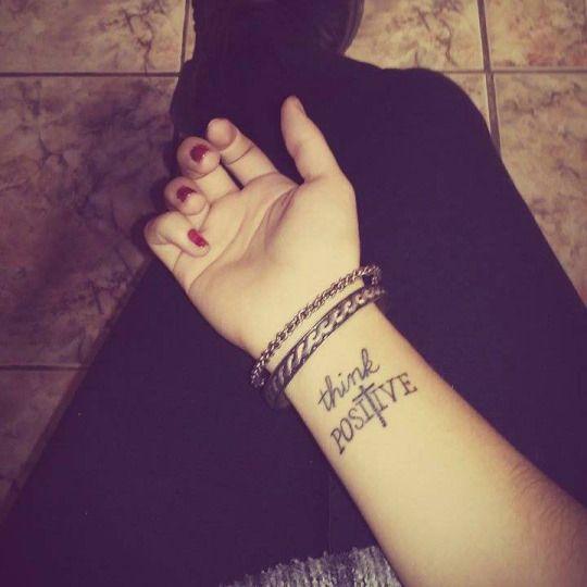Think positive wrist tattoo tatts pinterest tatouage au poignet pens es positives et - Tatouage pensee fleur ...