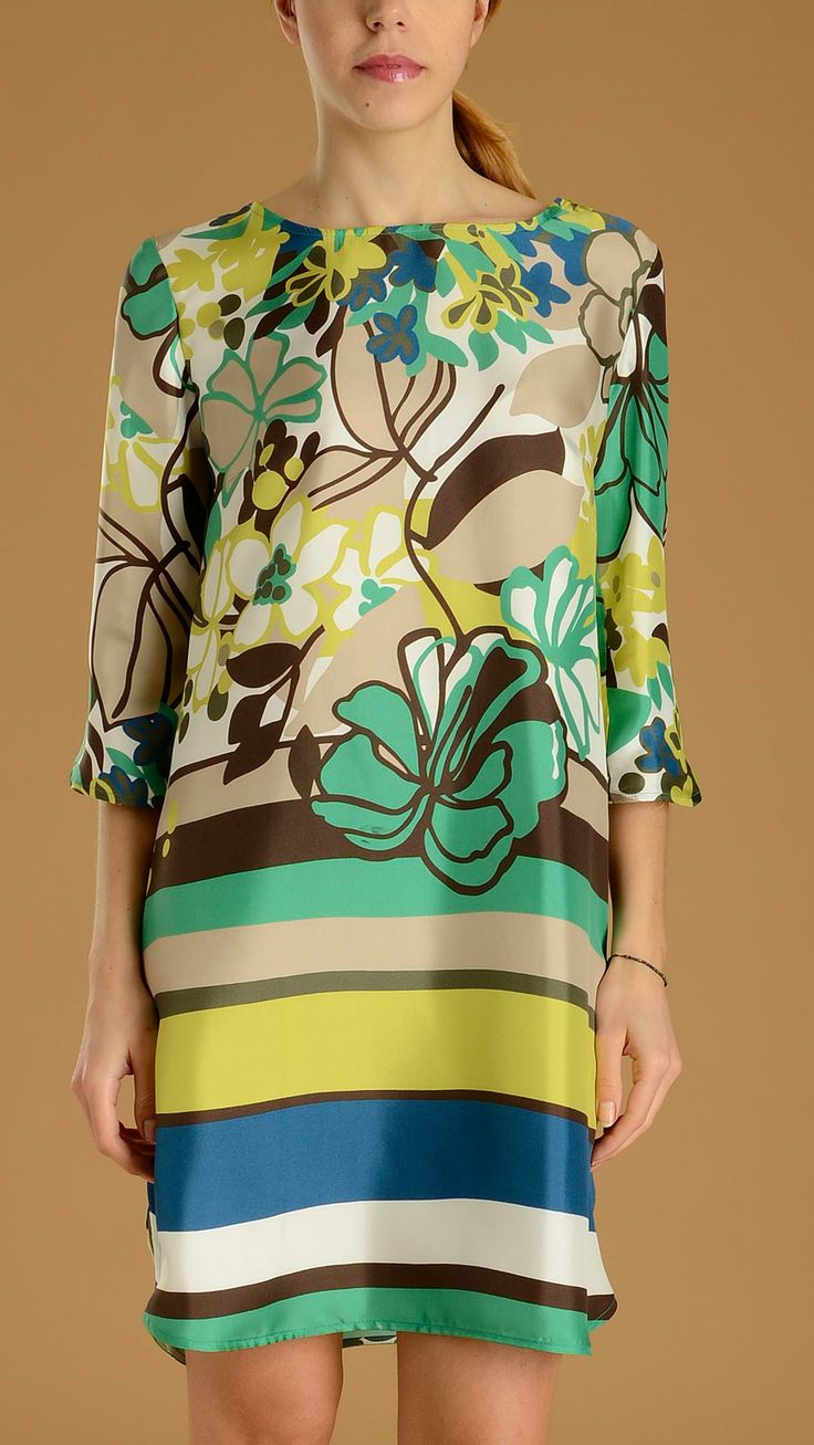 Floral pattern dress with three-quarter sleeves, wide boat neckline, small side slits.