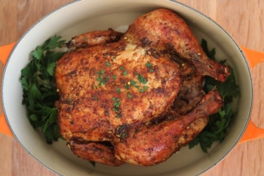 There are already so many different recipes for cooking a whole chicken, you might wonder why you need one more. But if you're a fan of store-bought rotisserie chicken, then you definitely need this one. Just like a cooked chicken from the market, the meat on this bird is plump, juicy and tender and the skin browned and deeply flavorful. Plus, this recipe is so simple and hands-off that it's basically as convenient as driving to the store to buy a rotisserie chicken. What's the secret? Low…