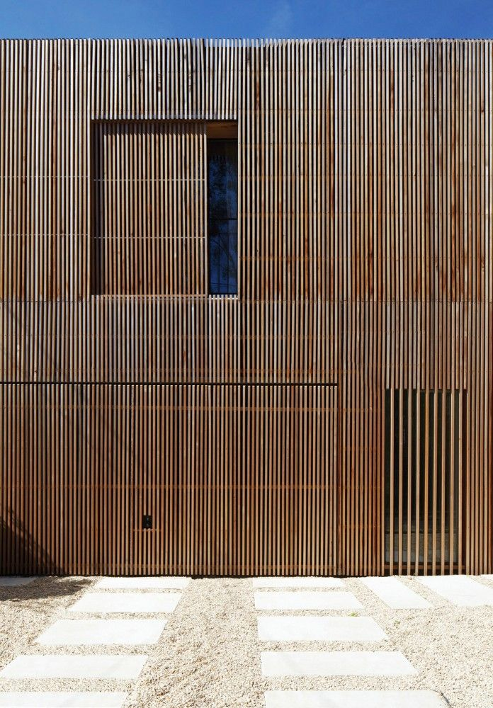 Maison 2G / Avenier Cornejo Architects Window screen slides behind main cladding.