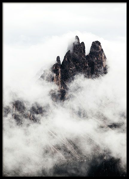 Poster with photo art. A stylish nature photo with high mountaintops and clouds. It makes a stylish decoration for your living room or the office. Looks great combined in a collage with some of our other nature photos found in the category, www.desenio.com