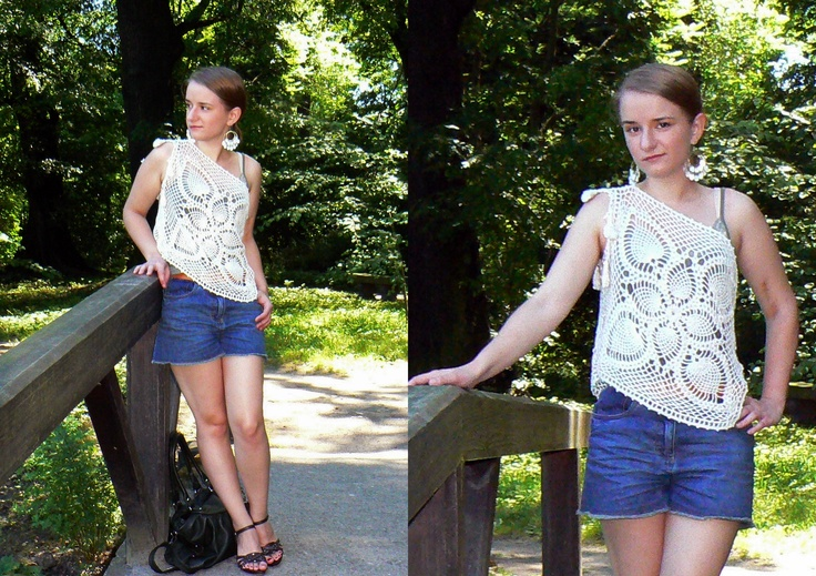 Asymmetrical crochet top with small tassels.