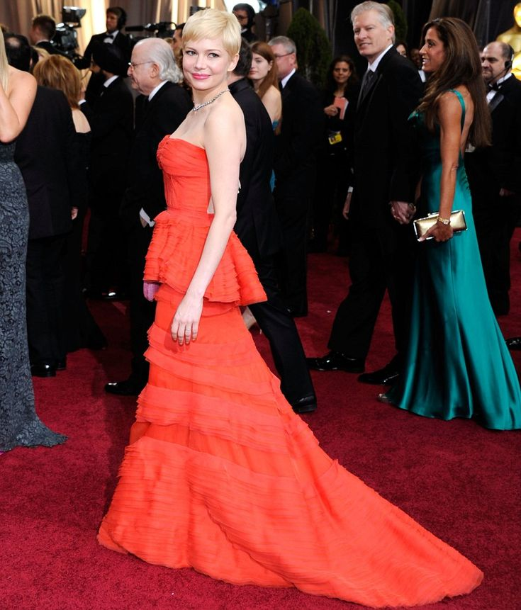 Michelle Williams looked incredible in her tiered bright coral Louis Vuitton dress