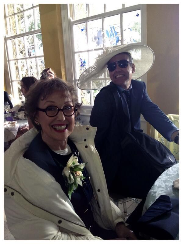 Louise's Twitter - Rupert in Una's hat. (I really wish these people would lighten up! They always look so miserable together.)