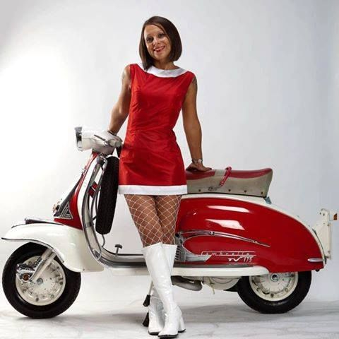 Anyone have one of these I think lambretta? Please gents dont ogle the young lady as its probably hers.
