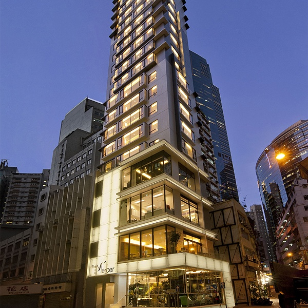 The 25-story Mercer has a striking glass-and-neon-clad exterior and hip, snazzy atmosphere.