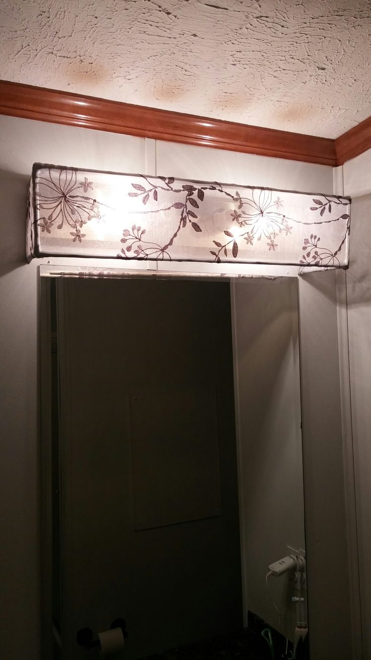DIY Vanity Light Shade Dowel rods and a curtain sheer hot glued and hung over existing vanity ...