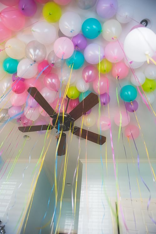 They snuck gobs of balloons in to her room the night for Birthday balloon ideas