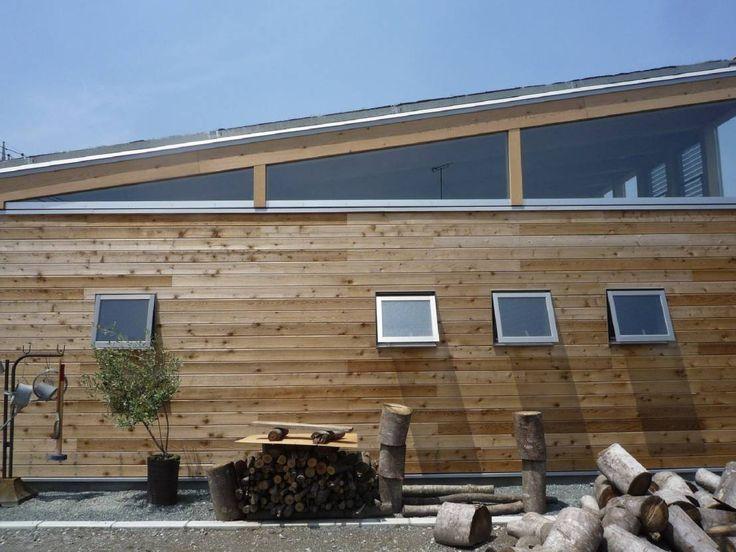無垢板の外壁|mat house : Eclectic style houses by KAZ建築研究室