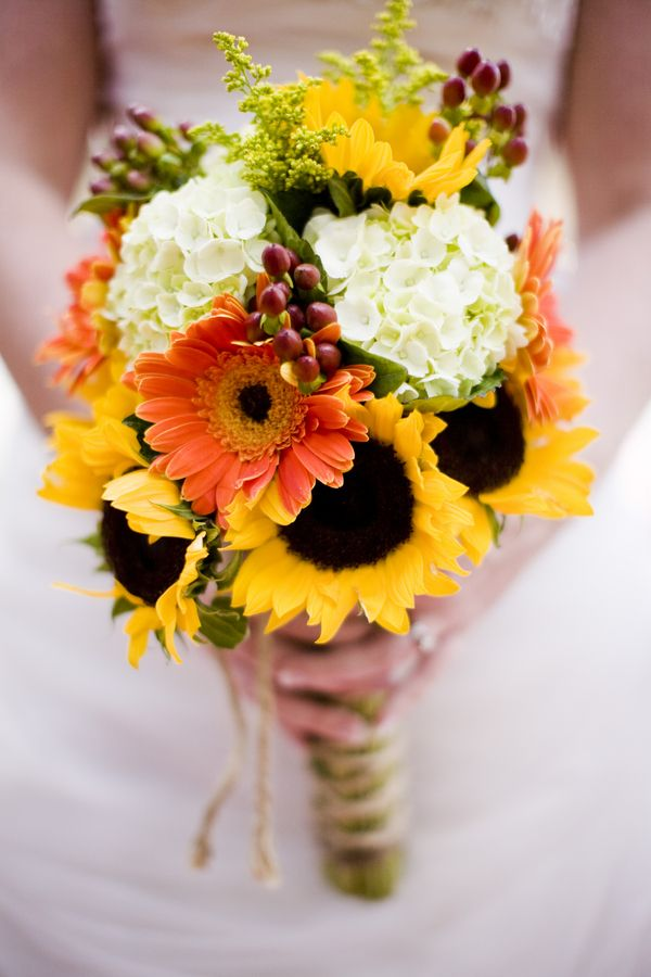 gold diamond engagement ring White hydrangea orange gerbera sunflowers and all tied with twine