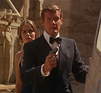"""Roger Moore as James Bond in """"The Spy Who Loved Me"""", with bow tie and midnight blue dinner suit.  The most dashing Bond yet!  Love him!"""