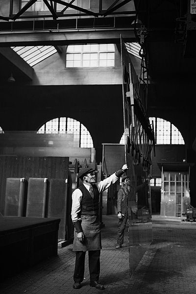 Glass Factory, March 16, 1934 Workers at Pilkington's glass blowing and stained glass window factory in Hoxton, east London. Sheets of glass are handled by suction. Long-gone East End London - Telegraph