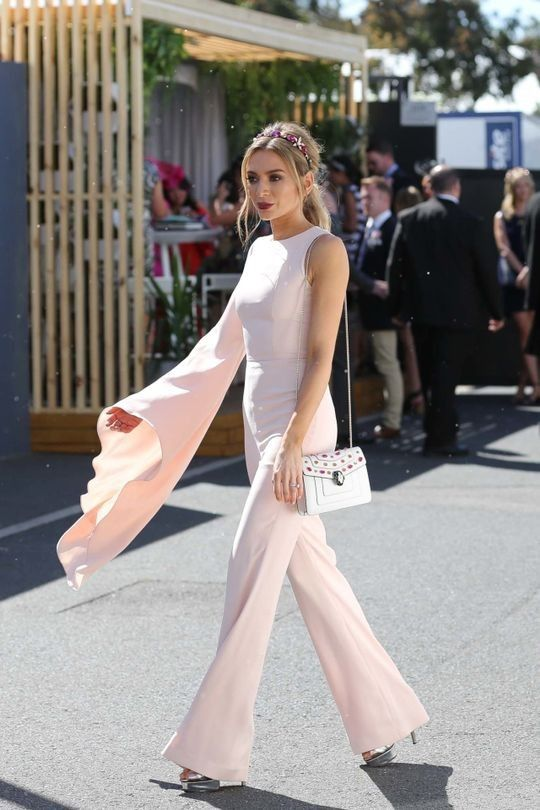 Oaks Day 2016: The best street style from the day: Nadia Bartel wearing Misha Collection jumpsuit, JY Jewels X Lady of Leisure millinery carrying Bulgari bag