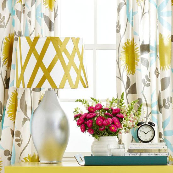 Have an ugly lamp?  Add some ribbon and spray paint and you can quickly customize to your space.