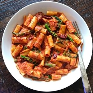 Rigatoni with veggies in a creamy Tomato Vodka Sauce– Gluten-free and Dairy-free. My son's favorite thing to order at a restaurant is pasta with vodka sauce. So we tried to recreate his favorite restaurant version at home, only healthier. Made with tomatoes and gluten-free vodka, the sauce gets its creaminess from tofu (don't worry if you don't love tofu, you can't taste it!).