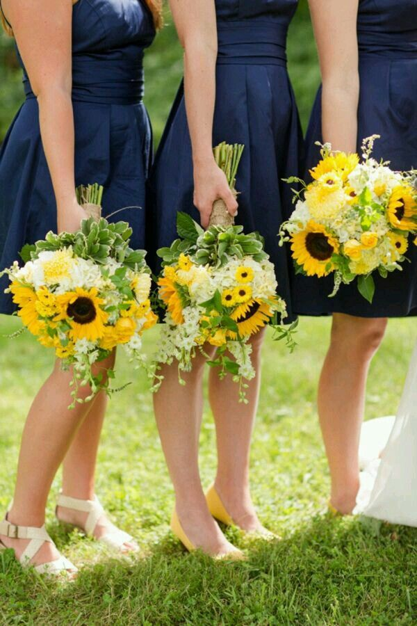 do i send wedding invitations to bridesmaids%0A Navy bridesmaids dresses   sunflower bouquets u   d reminds me og when my aunt  would takey cousin and i to get sunflowers for our hair