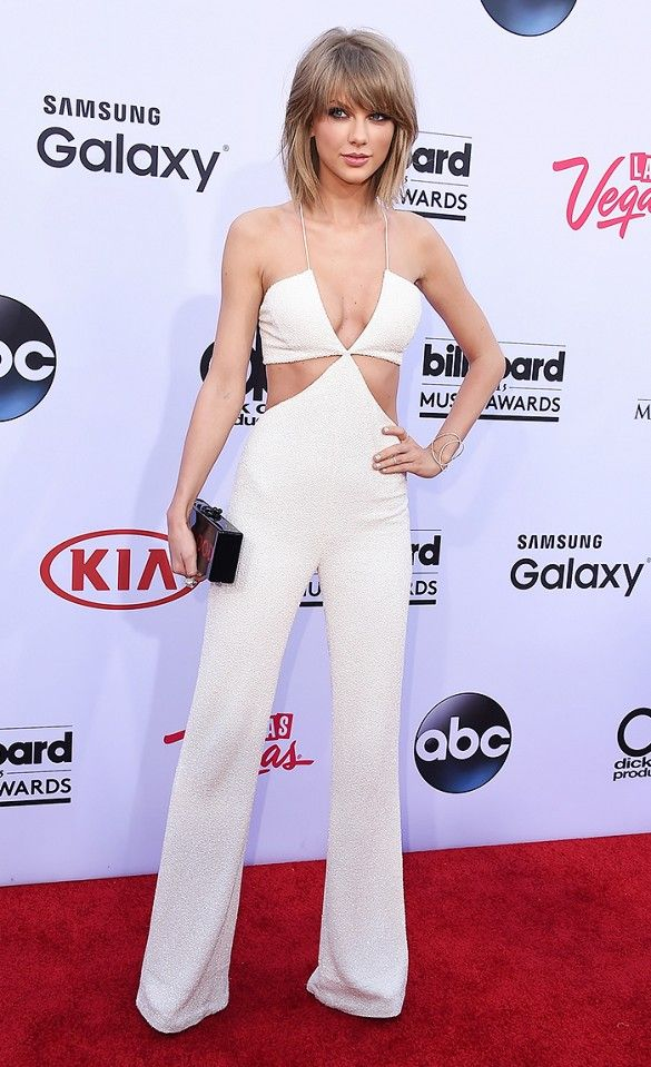 Taylor Swift in a Balmain jumpsuit, Effy Jewelry earrings, Edie Parker clutch, and Brian Atwood heels at the Billboard Music Awards.: