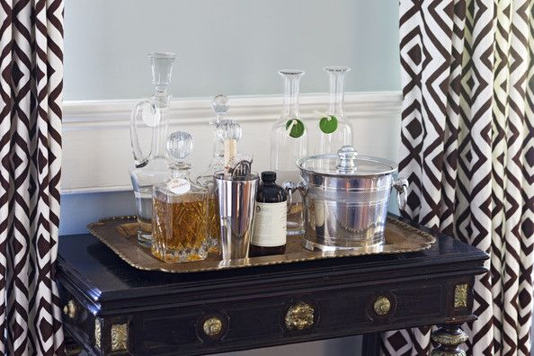 A tray of decanters and bar essentials.