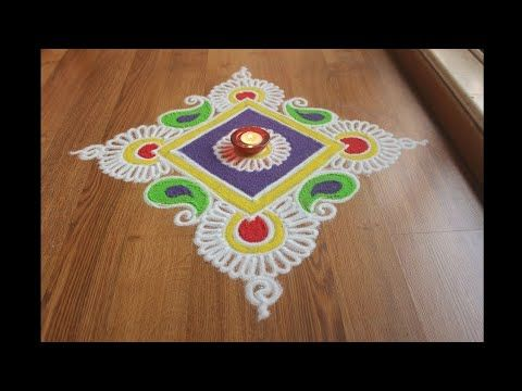 Here is a simple freehand diwali special flower rangoli design for Diwali. It is based on one of my original rangoli designs and I have tried to do some innovation with the placement of Diya in this rangoli. Diya has quite some significance in our culture and is the source of brightness in our festivals like Diwali, Navratri and Dussera. You can make the rangoli designs with the colours selection as shown in the video or add your own creativity with the colours. I will love to hear read…