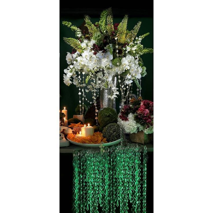 Welcome to the Twilight Zone of flowers.  Floral Design: KQ Elements  #kqelements #weddingdecor #weddingbouquets #weddingflowers #weddingideas #extravegant  #floralarrangements #floraldesigns #floraldecor #flower #sunflowers #weddingphotography #glamorous  #weddingflorals #weddings #bouquets #crystals #springwedding  #centerpieces #candles #weddingcenterpiece #brides #prettyflowers #bellsofireland #springflowers #ornithogalum #smpweddings #theknot #sweethearttable #orchids by kqelements