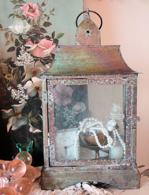 Great way to display small vintage items! If you can't find the perfect vintage lantern, Home Goods has cute lanterns on sale that would be great to display things in.
