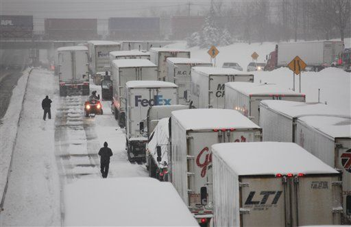 Vehicles are stranded on the New York State Thruway during a winter storm in Buffalo, N.Y., Thursday, Dec. 2, 2010.