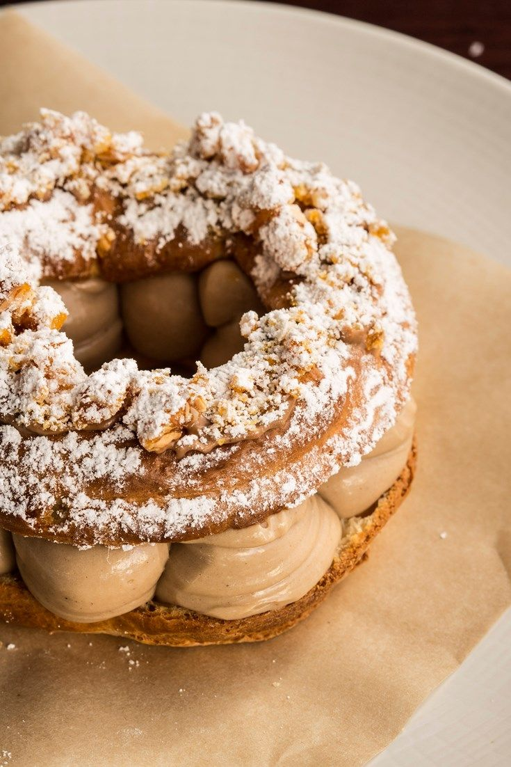 This classic Paris-Brest recipe from Merlin Labron-Johnson is a patisserie work of art, with crispy almond-topped choux pastry encasing mounds of silky praline cream.