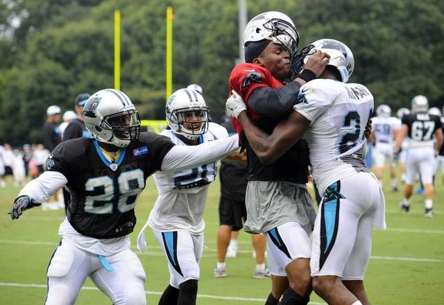 Carolina Panthers' Jonathan Stewart (28) reacts as Cam Newton (1) and Josh Norman (24) get into a skirmish in practice during Carolina Panthers Training Camp at Wofford College in Spartanburg, SC on Monday.