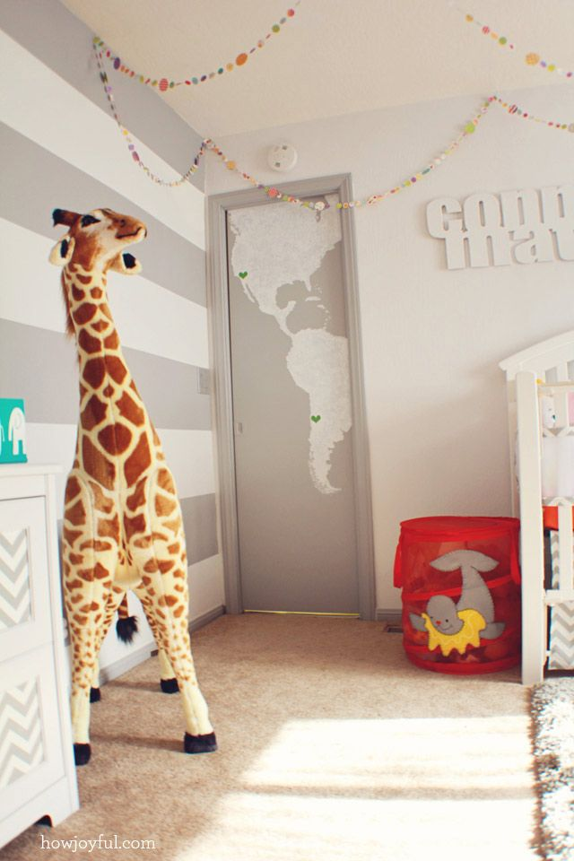Gray map design on the closet door and gray stripes as an accent.  #gray #nursery #stripewall #worldmap #genderneutral