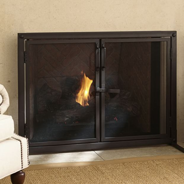 14 Modern Fireplace Screens For Every Budget Modern Fireplace Screen Industrial Fireplaces Fireplace Screens With Doors