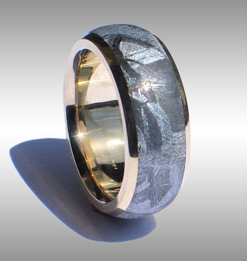 Gibeon Meteorite RIng with 14k gold lining & rails. I think I would be willing to sell my soul for this.