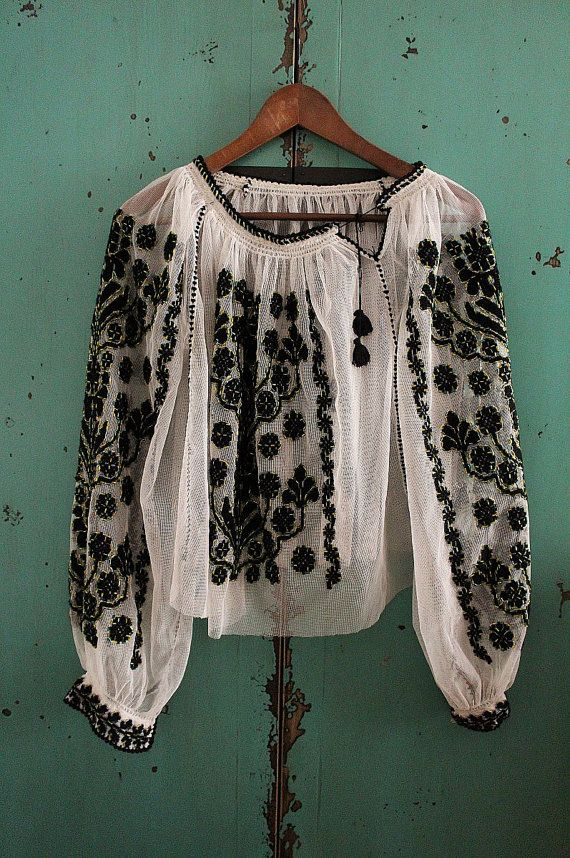 The beautiful embroidered tulle blouse has wonderful embroidery pattern with black soft threads, yellow and green colored glass tube beads.  It has