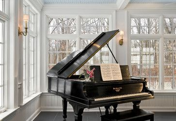 My dream an open baby grand piano with music and small floral arrangement.