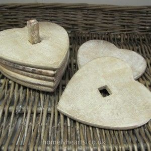 Wooden Heart Coasters. Set of six heart-shaped coasters from Sass & Belle.  Made from sustainable mango wood with a white wash effect. Guaranteed to be admired by all your visitors.