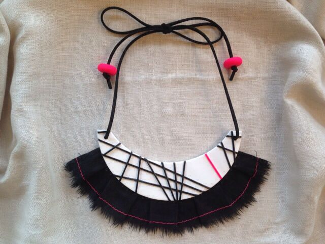 Handmade neck piece from polymer clay, linen fringing with contrasting stitching detail, and leather strap