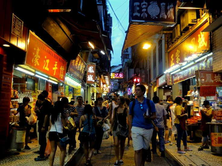Busy and narrow shopping streets of Macau old town.