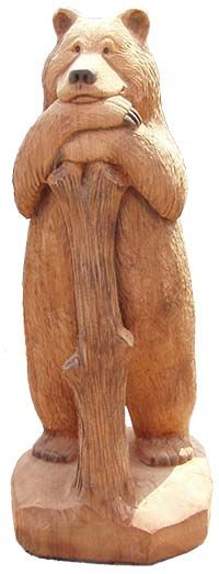 Wood carved bears, woodcarvings and wood sculptures by sculpture artist R. Large life size wooden carved Bear leaning on tree stump.