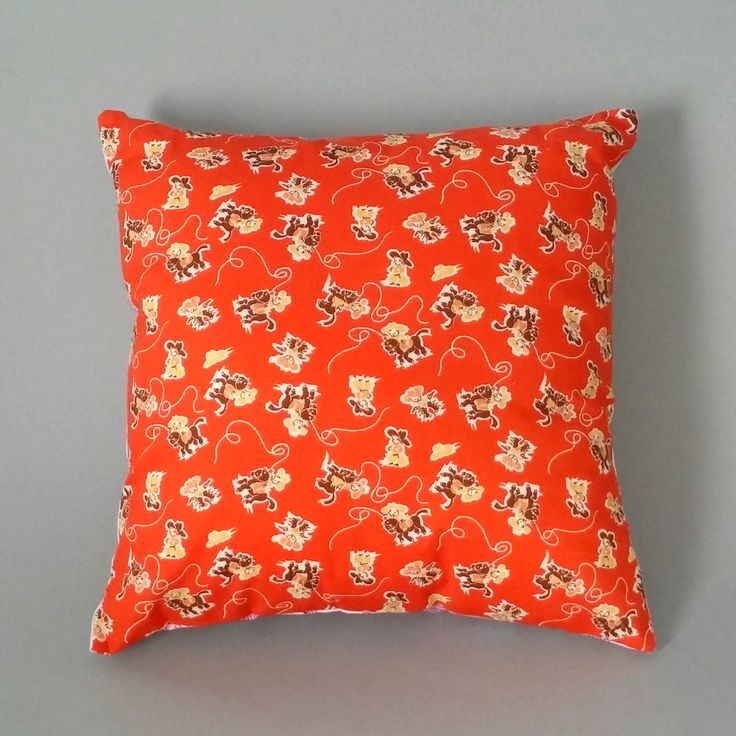 Our 'Orange Blossom Cowboys' cushion combines fab retro style cowboys on an orange background, with exotic Japanese orange blossoms on a white background