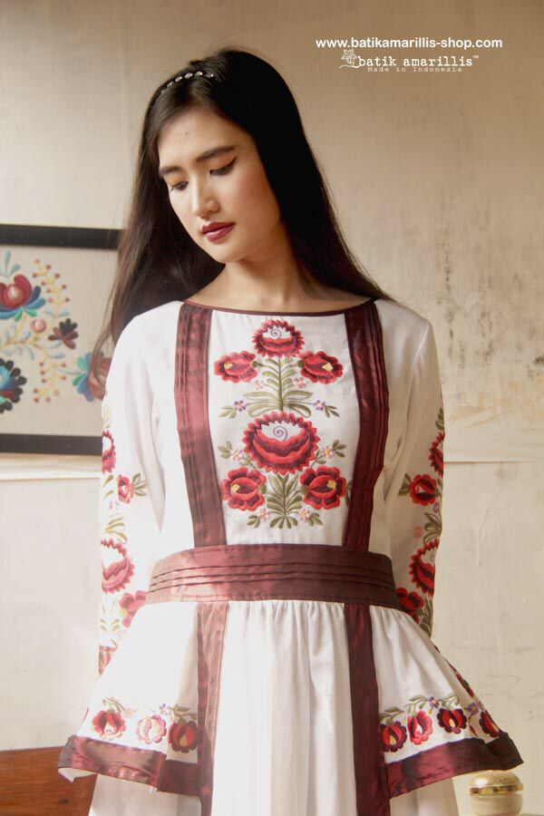 Batik Amarillis Made in Indonesia : proudly Presents..... Batik Amarillis's Joie de Vivre dress 2015 in Hungarian embroidery ....This Edwardian's era classy Tiered Dress inspired ,features pleating,side pockets,piping and Taffeta Lining details to create extra slimming's silhoutte!