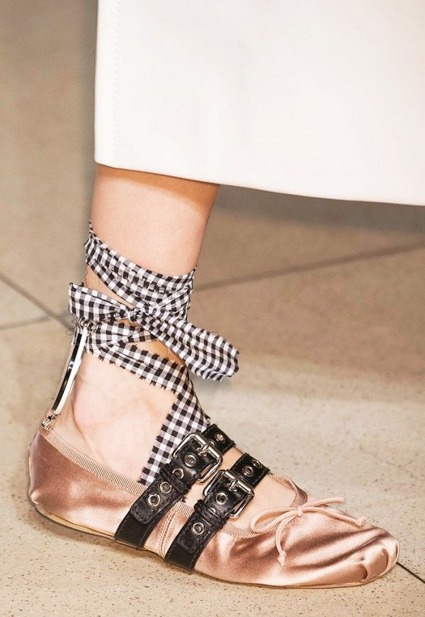 The Miu Miu ballet flats are worn with a white skirt