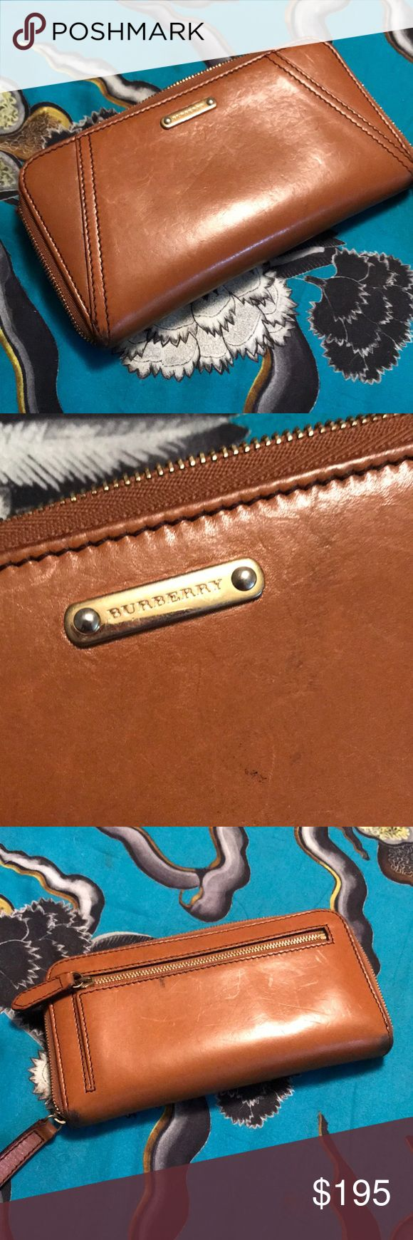 Burberry Slim Ziggy Wallet Great Burberry Zip Wallet with signature plaid inside.  Small signs of wear as shown. Purchased new at Burberry on Michigan Ave in Chicago. Guaranteed authentic!  THIS ITEM IS ALSO FOR SALE LOCALLY AND COULD BE GONE IMMEDIATELY! If you want it, better grab it! Make me an offer! Burberry Bags Wallets