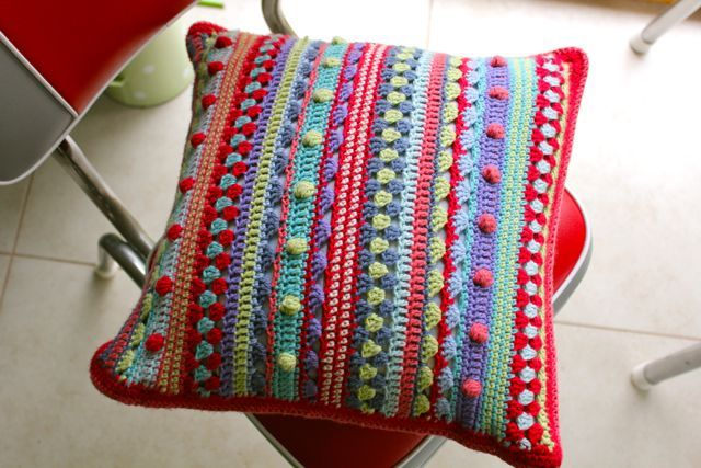 Stripy crochet cushion cover. I love the colours and the bobbles!