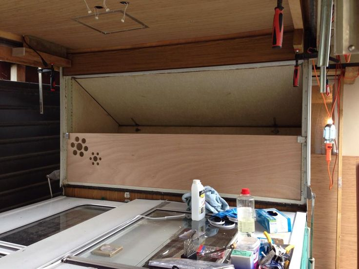 One end of the caravan folded out. A 2-year old sleeps here, so I made a side to stop her rolling out at night. A single bed folds/pops out each end of the caravan. They can easily hold an adult.