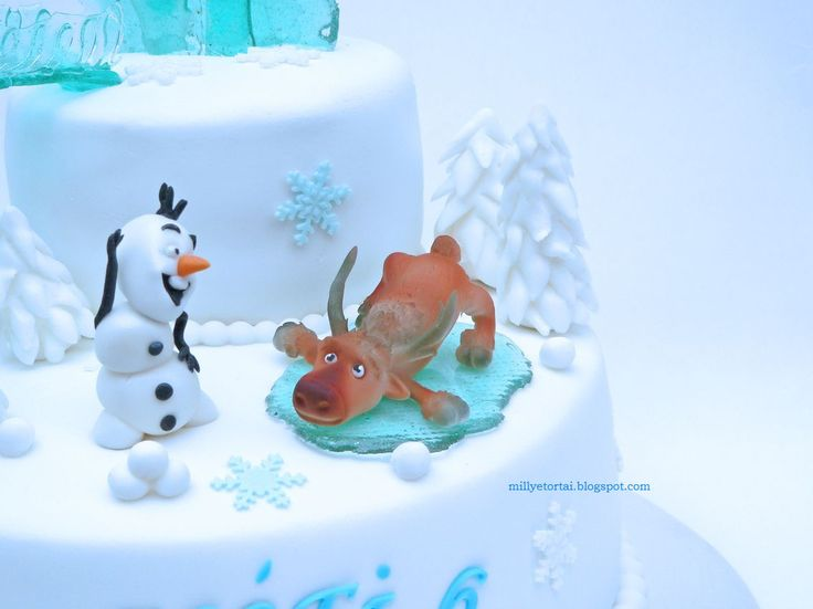 Frozen cake Olaf and Swen gumpaste figure