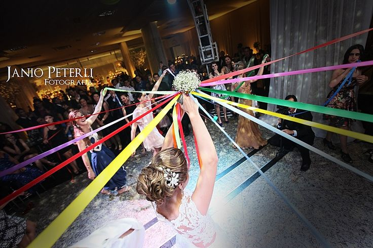 """Freshen up the traditional bouquet toss with this great idea! Cut the ribbons as you go, and the last guest holding an attached ribbon """"catches"""" the bouquet! #TrendTuesday"""