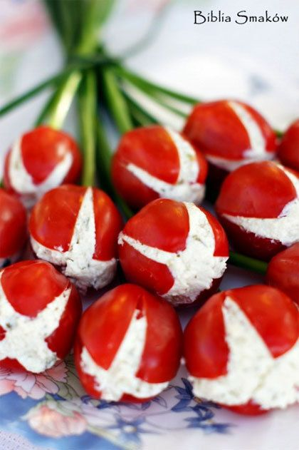 Jammy tulips! cherry tomatoes with herb cheese on a cucumber or other green sticks.