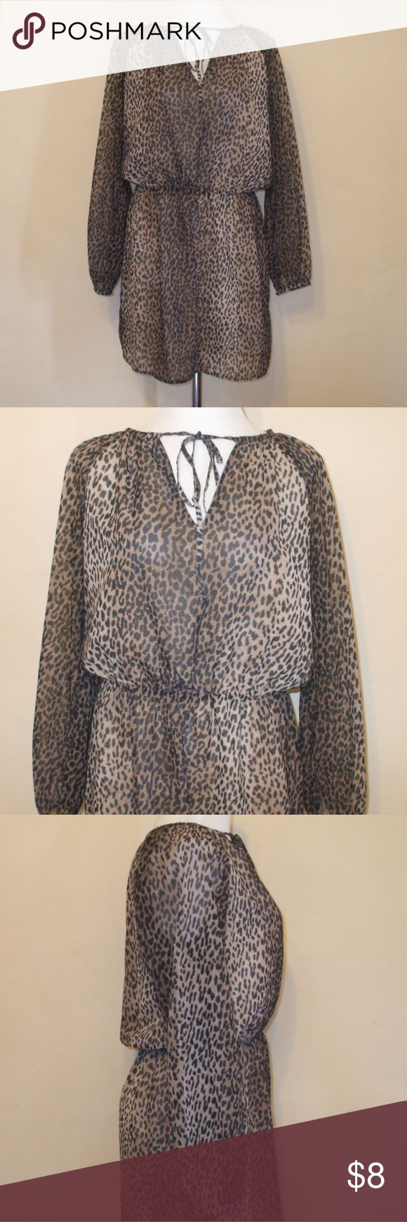 M N G Suit Animal Print Keyhole Dress M N G Suit Collection dress Size 4 Beige, brown, & black animal print Long sleeves - V neck with keyhole and tie  It is lined (except for the sleeves) 100% polyester Excellent pre-owned condition smoking home M N G Suit Collection Dresses