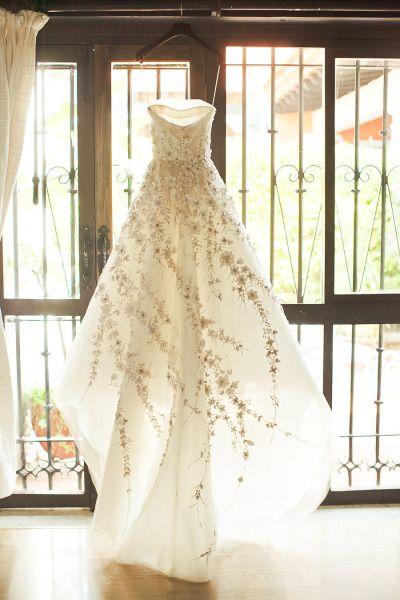 Floral detailed wedding dress: http://www.stylemepretty.com/destination-weddings/mexico-weddings/2013/10/10/oaxaca-mexico-wedding-from-orange-turtle-photography/   Photography: Orange Turtle - http://orangeturtlephotography.com/